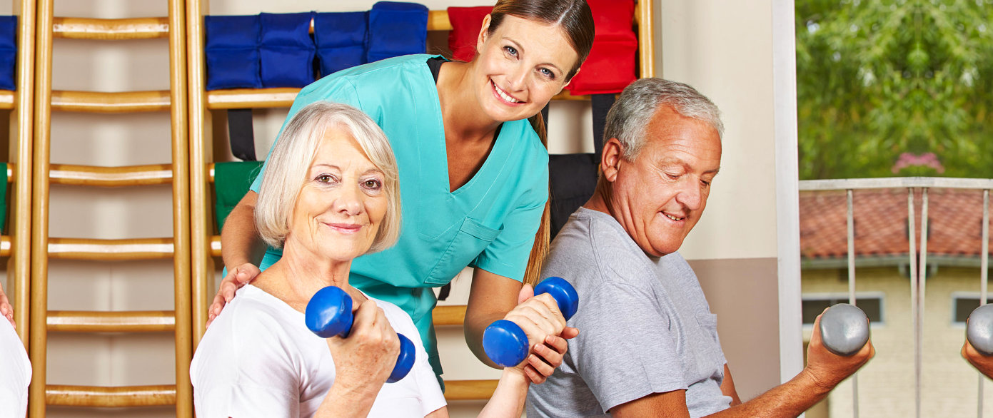 assisting elder couple in excercise