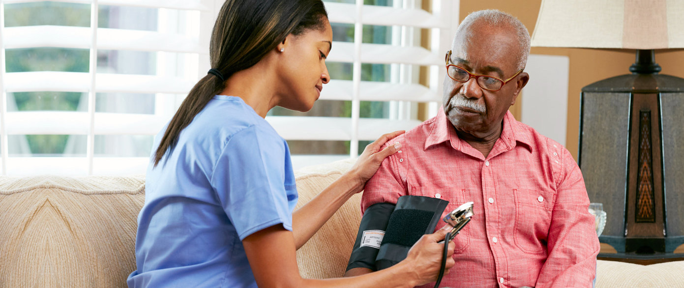 checking elder man blood pressure